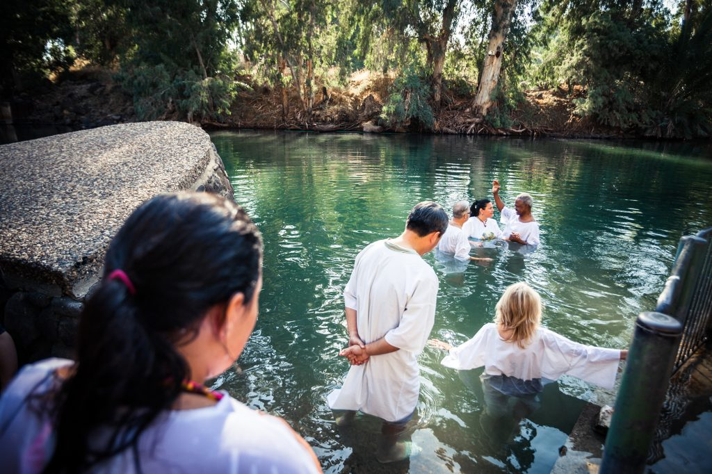 Israel. Yardenit baptismal site on the Jordan river is located just near the Sea of Galilea in the still clean section of the river. Thousands of tourists and pilgrims come here everyday thinking it is the real site where Jesus was baptised. The place is run by a Kibbutz. 3km ahead there is the Alumot Dam, which stops the Jordan river. After this dam only 9 million m3 is released added with waste water and salty water diverted from salty springs (not to pollute the Sea of Galilea, which is Israel's only fresh water reservoir).